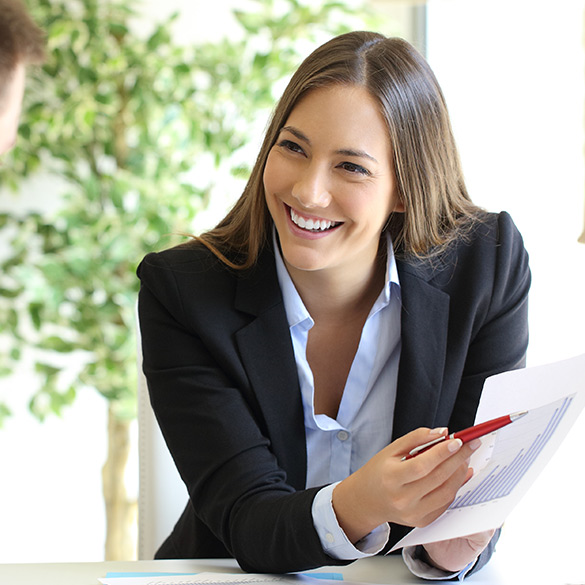 Professional woman pointing at a financial sheet